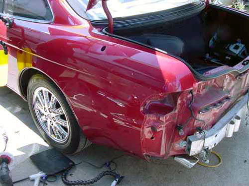 red car auto body damage before