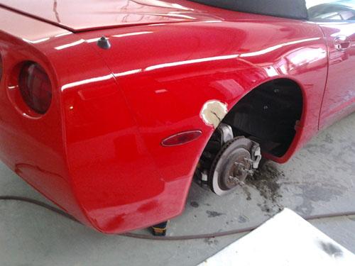 red corvette auto body damage before