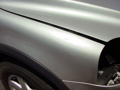 silver car fender auto body repair after