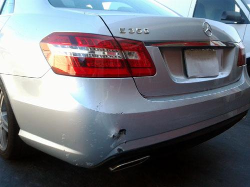 white mercedes bumper damage before